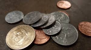 A pile of coins change representing cash back
